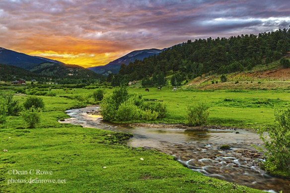 Sunset on a horse pasture and Upper Deer Creek, Bailey Colorado. The grass is lush after a wet spring.